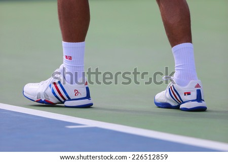 NEW YORK - SEPTEMBER 1 Six times Grand Slam champion Novak Djokovic wears custom Adidas tennis shoes during match at US Open 2014 at Billie Jean King National Tennis Center on September 1, 2014 in NY - stock photo