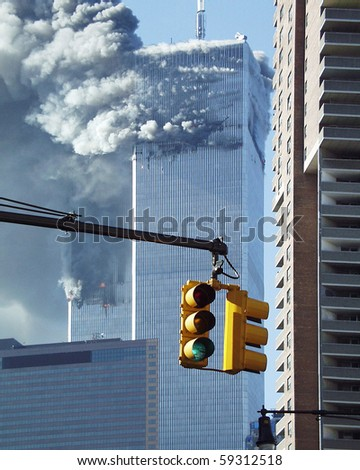 NEW YORK - SEPTEMBER 11: Smoke billows from the Twin Towers due to impact damage from airliners on September 11, 2001 in New York. View from Greenwich Street.