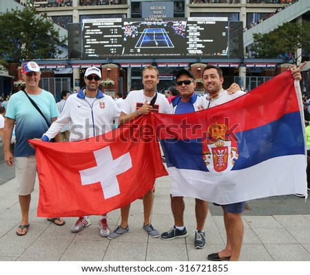 NEW YORK - SEPTEMBER 13, 2015: Swiss and Serbian tennis fans ready for men's final match at US OPEN 2015 between Roger Federer and  Novak Djokovic at Billie Jean King National Tennis Center in NY - stock photo