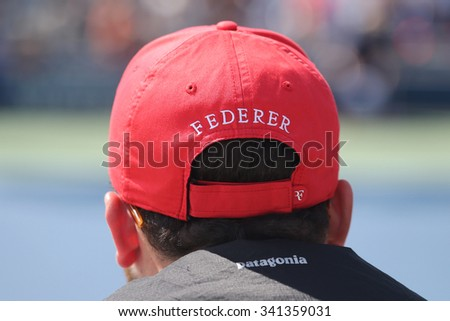 NEW YORK - SEPTEMBER 13, 2015: Tennis fan wears Roger Federer's hat during US Open 2015 match at Billie Jean King National Tennis Center in New York - stock photo