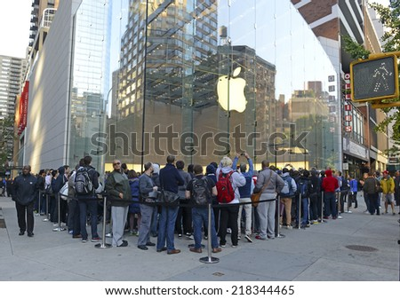 NEW YORK - SEPTEMBER 19, 2014. Thousands of loyal customers wait on long lines stretching many blocks outside the Apple Store in the Upper West Side of Manhattan for the iPhone 6 to go on sale. - stock photo