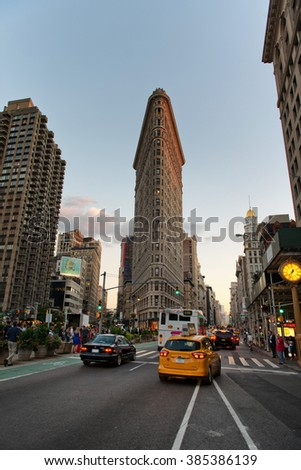 NEW YORK - SEPTEMBER 06 2015: Traffic Passing Through Intersection on Fifth Avenue Outside of Historic Flatiron Building in Early Evening, Manhattan, New York City, New York, USA - stock photo