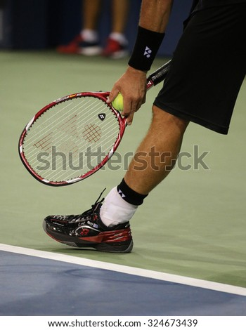 NEW YORK - SEPTEMBER 3, 2015: Two times Grand Slam Champion Lleyton Hewitt of Australia wears custom Lotto tennis shoes during second round match at US Open 2015 at  National Tennis Center - stock photo