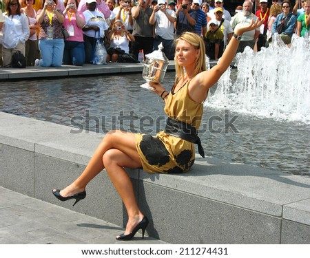 NEW YORK - SEPTEMBER 10: US Open 2006 champion Maria Sharapova holds US Open trophy in the front of the crowd after her win the ladies singles final on September 10, 2006 in New York.  - stock photo