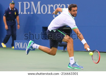 NEW YORK -SEPTEMBER 8: US Open 2014 champion Marin Cilic during final match against Kei Nishikori at Billie Jean King National Tennis Center on September 8, 2014 in New York  - stock photo