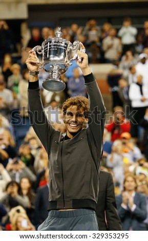 NEW YORK - SEPTEMBER 9, 2013: US Open 2013 champion Rafael Nadal holding US Open trophy during trophy presentation after his win against Novak Djokovic at National Tennis Center  in New York - stock photo