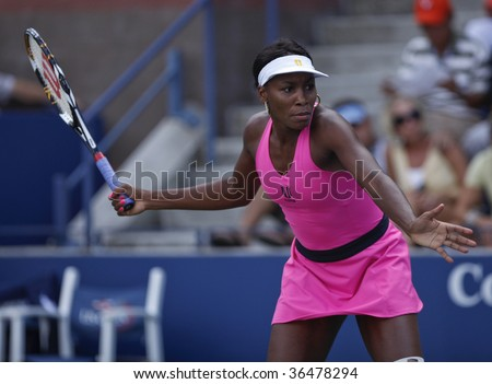 NEW YORK - SEPTEMBER  3: Venus Williams of USA returns a shot during 1st round doubles match against Julia Goerges of Germany and Arantxa Santonja of Spain at US Open on September 3, 2009 in New York.