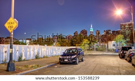 NEW YORK - SEPTEMBER 10: View of Manhattan Skyline from Long Island City on September 10, 2013. Manhattan is geographically the smallest yet densest of all New York City's five boroughs. - stock photo