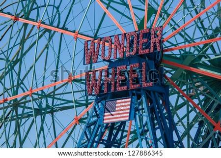 NEW YORK - SEPTEMBER 29: Wonder Wheel located at Deno's Wonder Wheel Amusement Park in Coney Island NY on September 29 2012. Wonder Wheel was build in 1920 and was declared a historic landmark in 1989 - stock photo