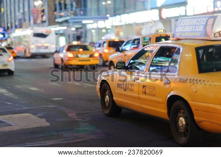 NEW YORK - SEPTEMBER 28: yellow cabs at area near Times Square at night on September 28, 2011 in New-York, USA. Times Square is a major commercial intersection and a neighborhood in Midtown Manhattan - stock photo