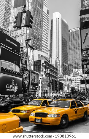 NEW YORK - SEPTEMBER 20: Yellow taxi cabs ride on the Time Square on September 20 2013 in New York, USA. Times Square is major commercial intersection and the most visited tourist attractions in NY. - stock photo