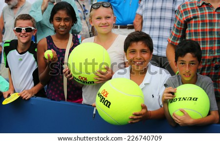NEW YORK - SEPTEMBER 1: Young tennis fans waiting for autographs at Billie Jean King National Tennis Center on September 1, 2014 in New York. US Open is a final Grand Slam tournament of the year - stock photo