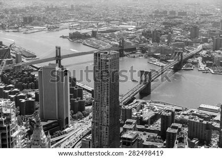 New York skyline and Brooklyn Bridge - stock photo