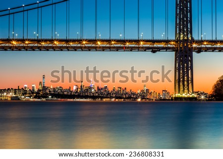 New York skyline at sunset framed by George Washington Bridge