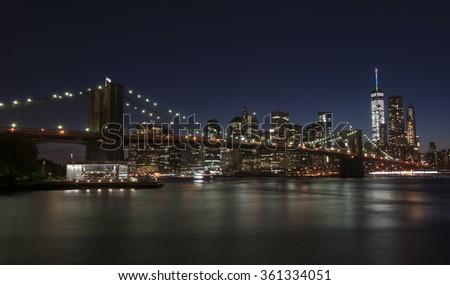 New York skyline showing Brooklyn Bridge. - stock photo