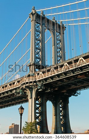 New York: skyscrapers and Manhattan Bridge viewed from Brooklyn on September 16, 2014. The Manhattan Bridge, known as the famous landmark, opened to traffic in 1909 and has a main span of 1470 feet - stock photo