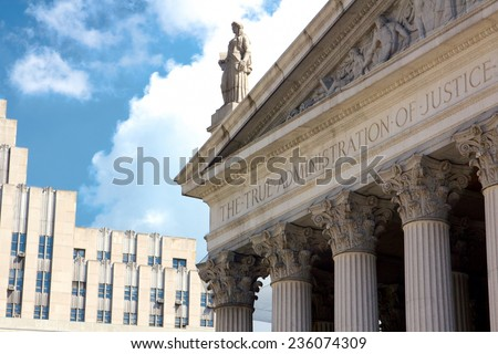 "New York State Supreme Court building in Lower Manhattan showing the words ""The True Administration of Justice"" on its facade in New York, NY, USA. - stock photo"