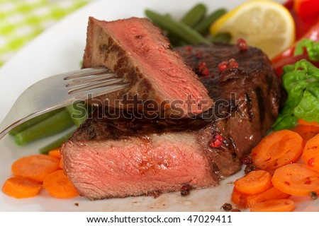New York Steak- meat on Carrot,Pepper and green salad over plate - stock photo