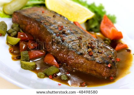 New York Steak- meat on Green Salad,Red Bell Pepper and Capers over plate - on Sauce - stock photo