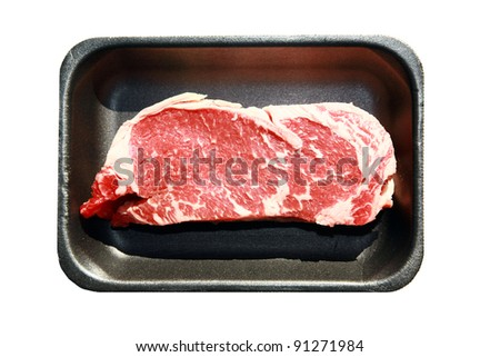 New York Steak, raw meat, on a black foam tray isolated on white with room for your text - stock photo