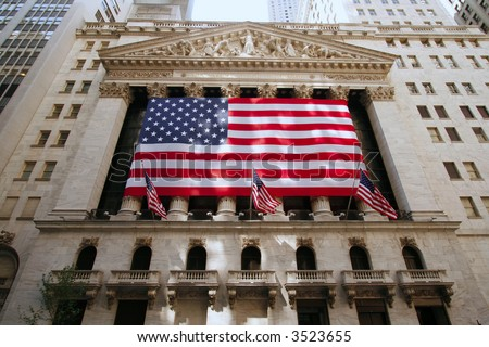 New York Stock Exchange Building draped with American flag. (Editorial Use Only)