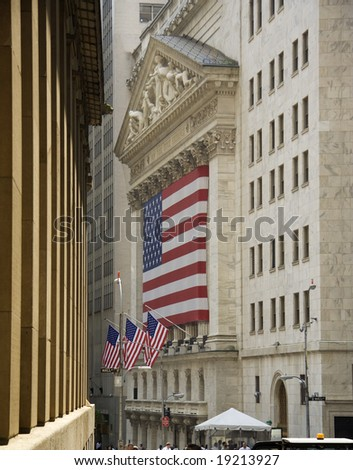 New York Stock Exchange building with American flag, Wall Street, New York, USA