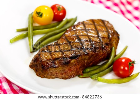 New York Strip Steak with green Beans - stock photo