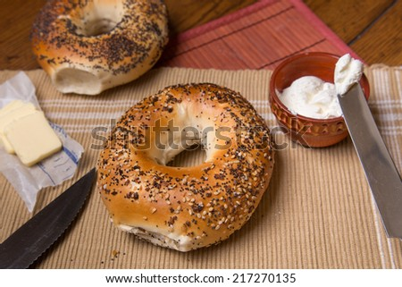 New York style bagels in setting with butter and cream cheese - stock photo