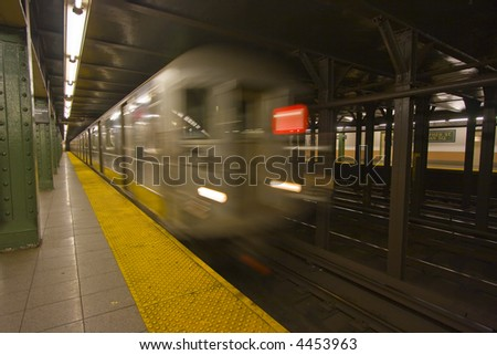 New York subway speeding by a platform with motion blur - stock photo