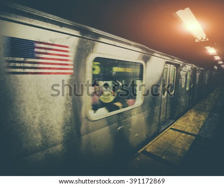 New York subway train moving through station with vintage filter effect - stock photo