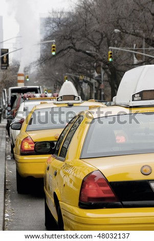 New York Taxi lined on Fifth Avenue - stock photo