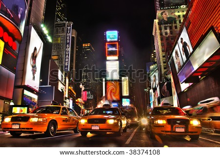 New York Times Square At Night. All logos and trademarks are obscured.  I am the copyright holder of all photos/art composed into the image. - stock photo