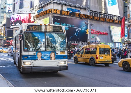 NEW YORK,U.S.A-JULY 6,2015:Public Transportation Bus close to Times Square. New York is a major city in the U.S and a tourist landmark visited by thousands daily. - stock photo