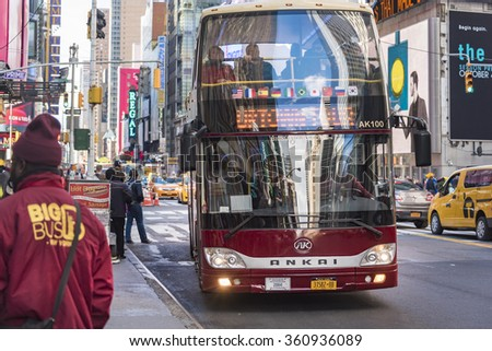 NEW YORK,U.S.A-JULY 6,2015:Tourist tour Bus.Red double-decker bus driving in a prominent street. New York is a major city in the U.S and a tourist landmark visited by thousands daily.