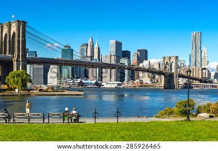 New York, U.S.A. - October 6 2010: Brooklyn, people on a garden with Manhattan and Brooklyn bridge in the background - stock photo