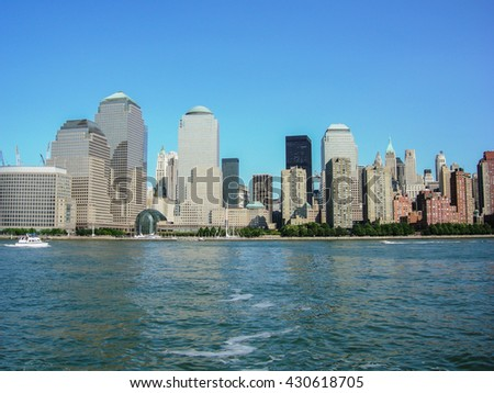 NEW YORK, UNITED STATES - AUGUST 14, 2009 -  view of new york skyline of skyscrapers and the Brooklyn Bridge from the river