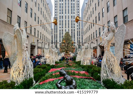 NEW YORK, UNITED STATES - DECEMBER 29, 2015 -  Christmas in New York with Christmas tree lights and decorations in the main streets of the Big Apple Rockefeller Center - stock photo