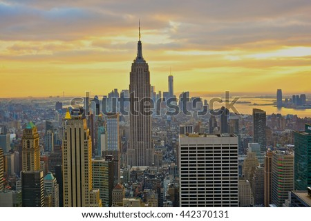NEW YORK, UNITED STATES - DECEMBER 28, 2015 - landscape of the skyscrapers of New York at sunset with empire state bulding views