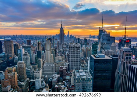 NEW YORK, UNITED STATES - DECEMBER 28, 2015 -  New York City skyline with urban skyscrapers at sunset.
