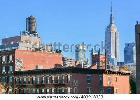 NEW YORK, UNITED STATES - DECEMBER 29, 2015 - panoramic view of the Empire State Building from The High Line park in New York United States