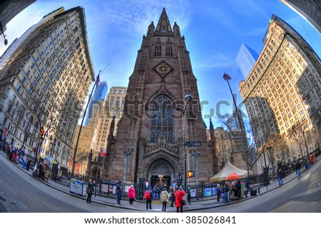 NEW YORK, UNITED STATES - FEB 6 Colorful HDR image of New York's Trinity Church seen from Wall Street through fisheye lens. Trinity Church is a historic, active, parish church. NYC, USA, Feb 6, 2016