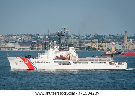 NEW YORK, UNITED STATES  - FEBRUARY 29, 2011 : US coast guard boat is navigating near the upper bay at New York. Brooklyn buildings on the Background. - stock photo