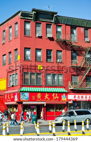 NEW YORK,  UNITED STATES OF AMERICA - OCTOBER 17, 2015 : Colorful brick building in China Town of New York on October 17, 2011. China Town is very attractive place to visit  in New York.
