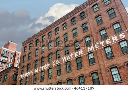 NEW YORK, USA - Apr 29, 2016: Thompson Water Meter Building. DUMBO, Brooklyn. An old water meter company building in New York. Architectural Style - American Round Arch Factory