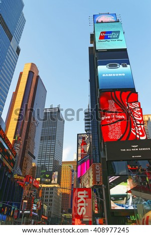 New York, USA - April 26, 2015: Broadway and 7th Ave skyscrapers in Midtown Manhattan in New York, USA. It is called Times Square. It is a commercial junction of Broadway and 7th Avenue. - stock photo