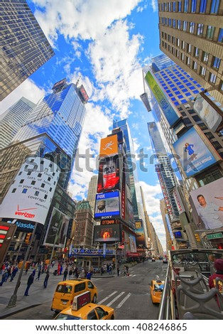 New York, USA - April 24, 2015: Broadway and 7th Avenue in Times Square from excursion bus. Skyscrapers in Midtown Manhattan in New York, USA. Tourists in the street