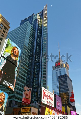 NEW YORK, USA - APRIL 26, 2015: Broadway skyscrapers in Midtown Manhattan, New York, USA. It is called Times Square. It is a commercial intersection between Broadway and 7th Avenue. - stock photo