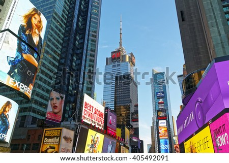 NEW YORK, USA - APRIL 26, 2015: Broadway skyscrapers of Midtown Manhattan, New York, USA. It is called Times Square. It is a commercial intersection between Broadway and 7th Avenue. - stock photo