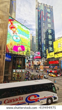 New York, USA - April 25, 2015: Crossroad in Times Square in New York, Skyscrapers in Midtown Manhattan in New York, USA. Tourists in the street - stock photo