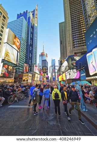 New York, USA - April 25, 2015: Crowded with tourists 7th Avenue and Broadway in Times Square. Skyscrapers in Midtown Manhattan in New York, USA. It is a commercial junction of Broadway and 7th Avenue - stock photo